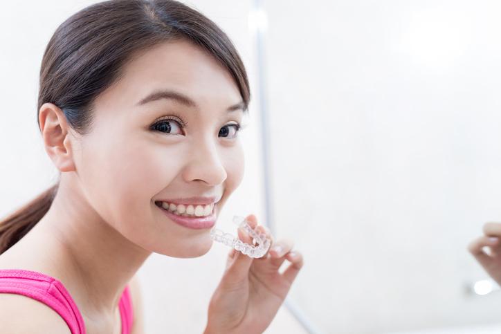 woman with invisilign - Monterey Orthodontics.